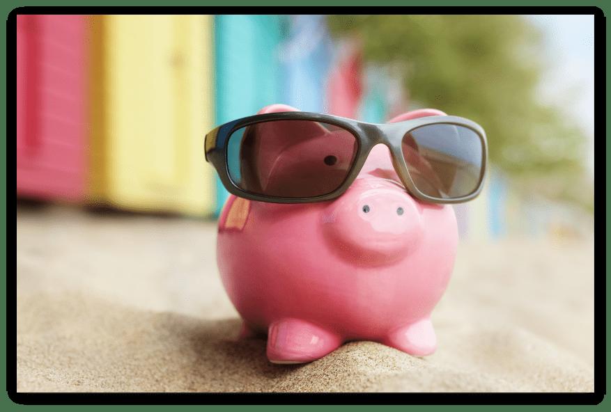 piggy-bank-on-beach-vacation-P8YZYNB